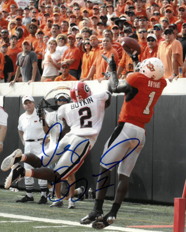 Dez Bryant signed Oklahoma State Cowboys 8X10 Photo #1 (orange jersey)- PSA/JSA/BAS Guaranteed To Pass