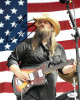 Chris Stapleton signed 8x10 Photo (Guitar/Flag)- JSA Hologram #P62221 (country music/entertainment)