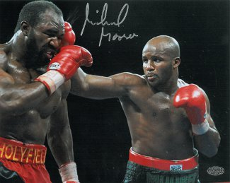 Michael Moorer signed Boxing 8x10 Photo vs Evander Holyfield (Heavyweight Champion)