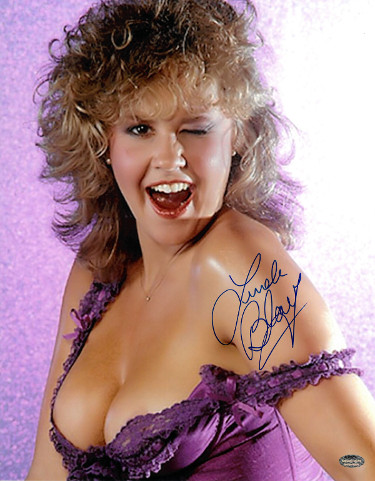 Linda Blair signed Sexy Pose 11x14 Photo (winking-blue sig)