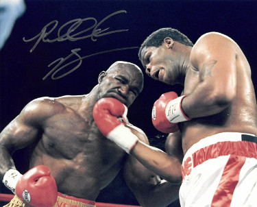 Riddick Bowe signed Boxing 8x10 Photo (vs Evander Holyfield)