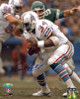 Earl Campbell signed Houston Oilers 8X10 Photo (white jersey)- Tri-Star Hologram