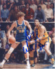 Bill Walton signed UCLA Bruins 8X10 Photo (blue jersey dribble- vertical)