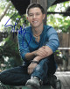 Scotty McCreery signed 8x10 Photo (vertical/trees background)- PSA/JSA/BAS Guaranteed To Pass