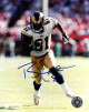 Torry Holt signed St. Louis Rams 8X10 Photo (white jersey run)