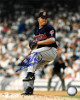Bartolo Colon signed Cleveland Indians 8x10 Photo #40 (navy jersey/wind up)