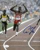 Carl Lewis signed Team USA 8x10 Photo (finish)- JSA Witnessed Hologram (Olympics)