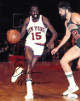 Earl Monroe signed New York Knicks 8x10 Photo- JSA Hologram (black sig vs Bucks)